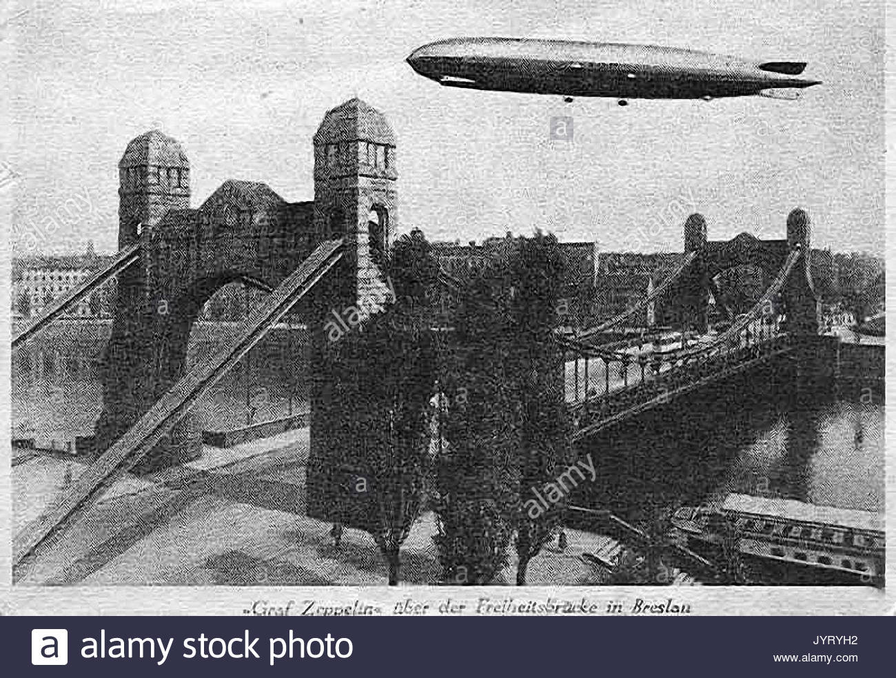 https://c8.alamy.com/comp/JYRYH2/old-photograph-showing-graf-zeppelin-flying-over-breslau-in-germany-JYRYH2.jpg