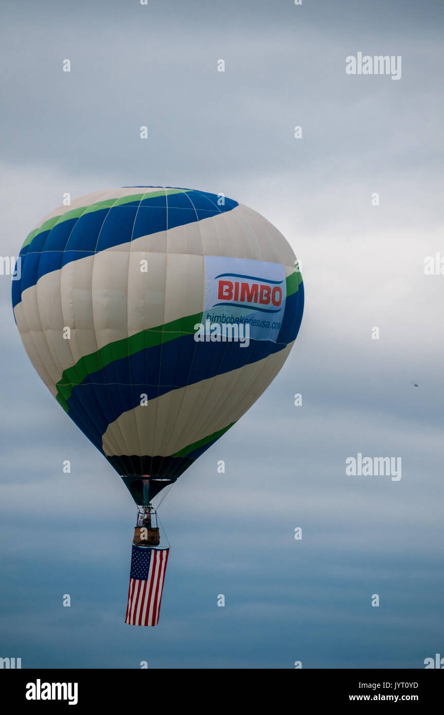 The Bimbo Bakeries hot air baloon takes off leading the mass ascension, Albuquerque Balloon Fiesta, New Mexico, USA. - Stock Image