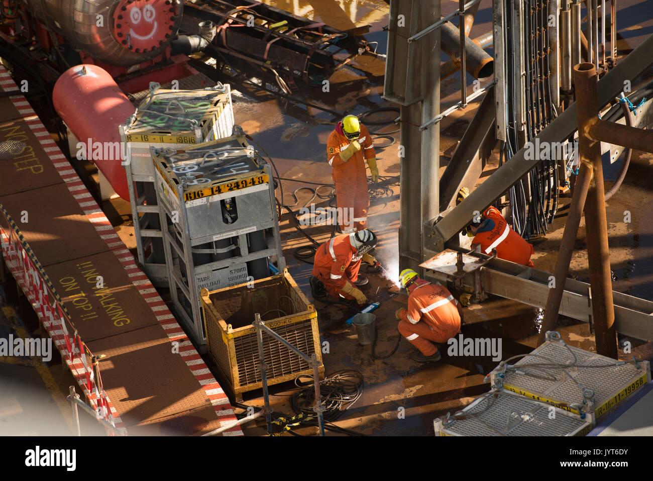 Welders fixing a structure to the deck of the Saipem S7000 heavy lifting vessel. credit: LEE RAMSDEN / ALAMY - Stock Image