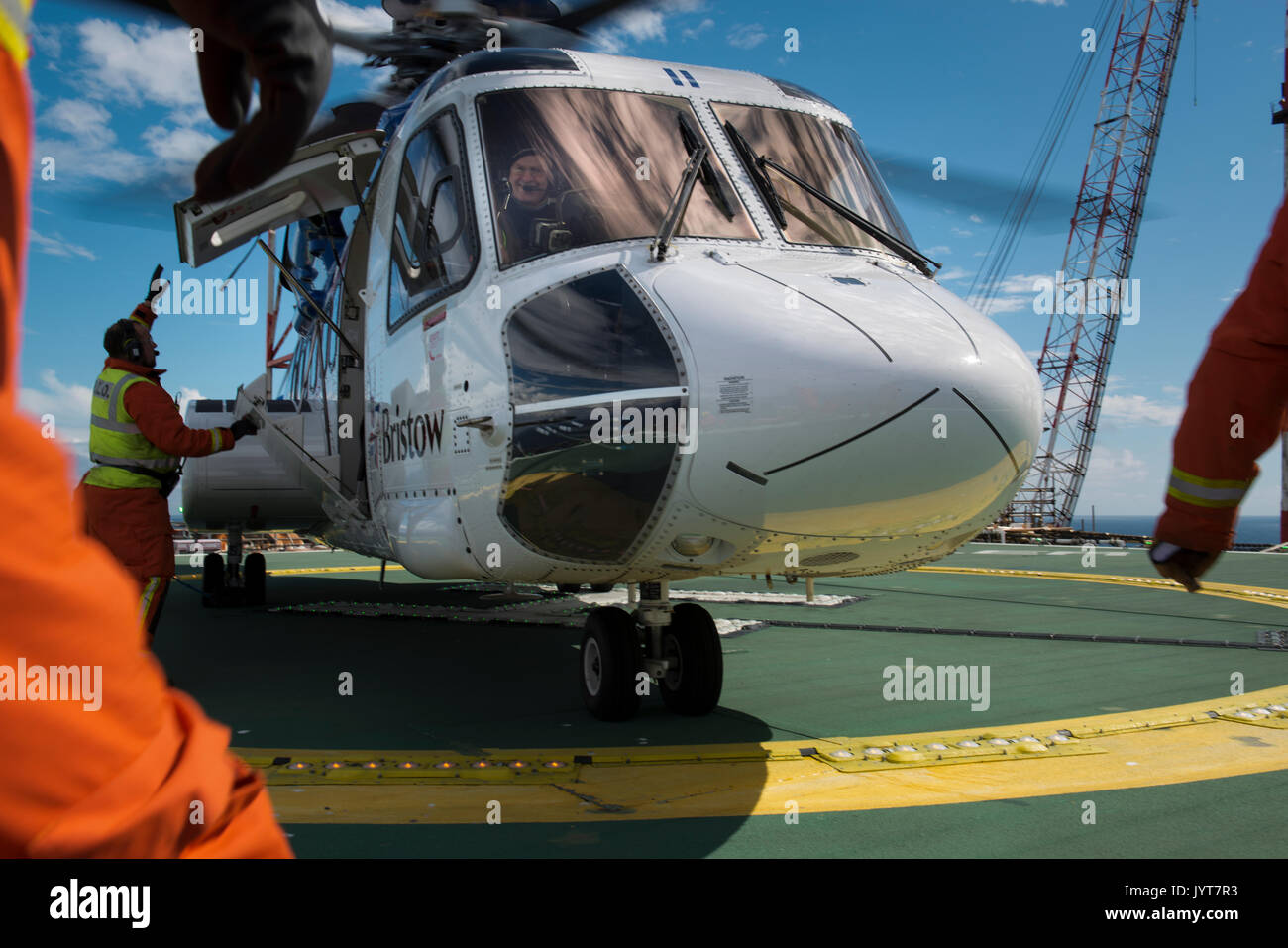 Bristow Helicopter, landing on a north sea oil and gas platform. Helideck team, credit: LEE RAMSDEN / ALAMY - Stock Image
