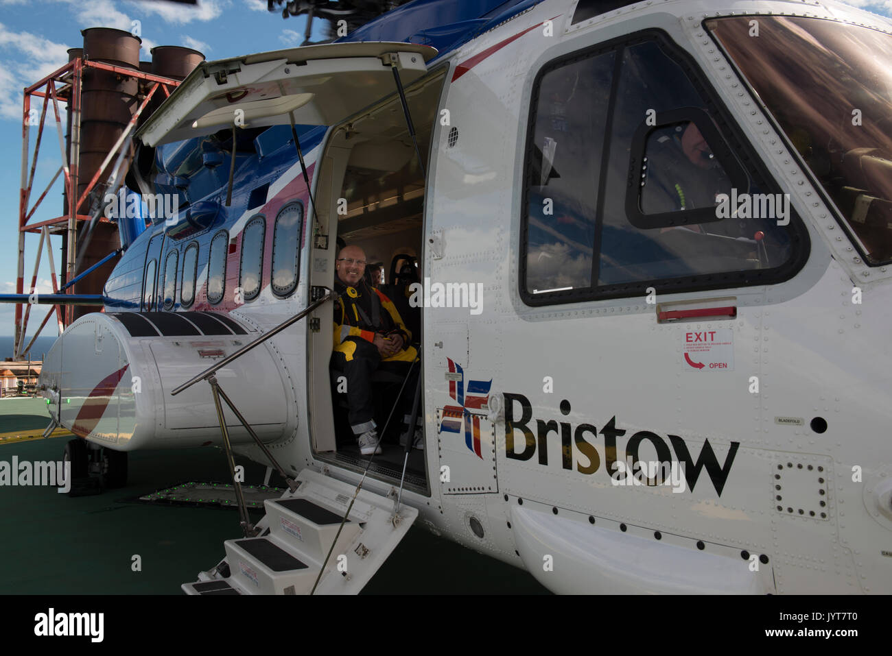 Bristow Helicopter, landing on a north sea oil and gas platform. credit: LEE RAMSDEN / ALAMY - Stock Image