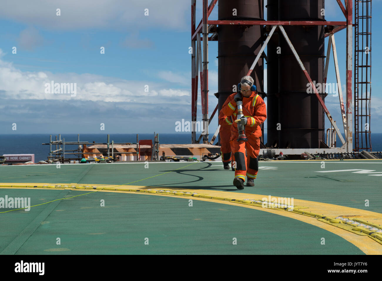 North sea oil and gas platform. Helideck team, refuelling. credit: LEE RAMSDEN / ALAMY - Stock Image