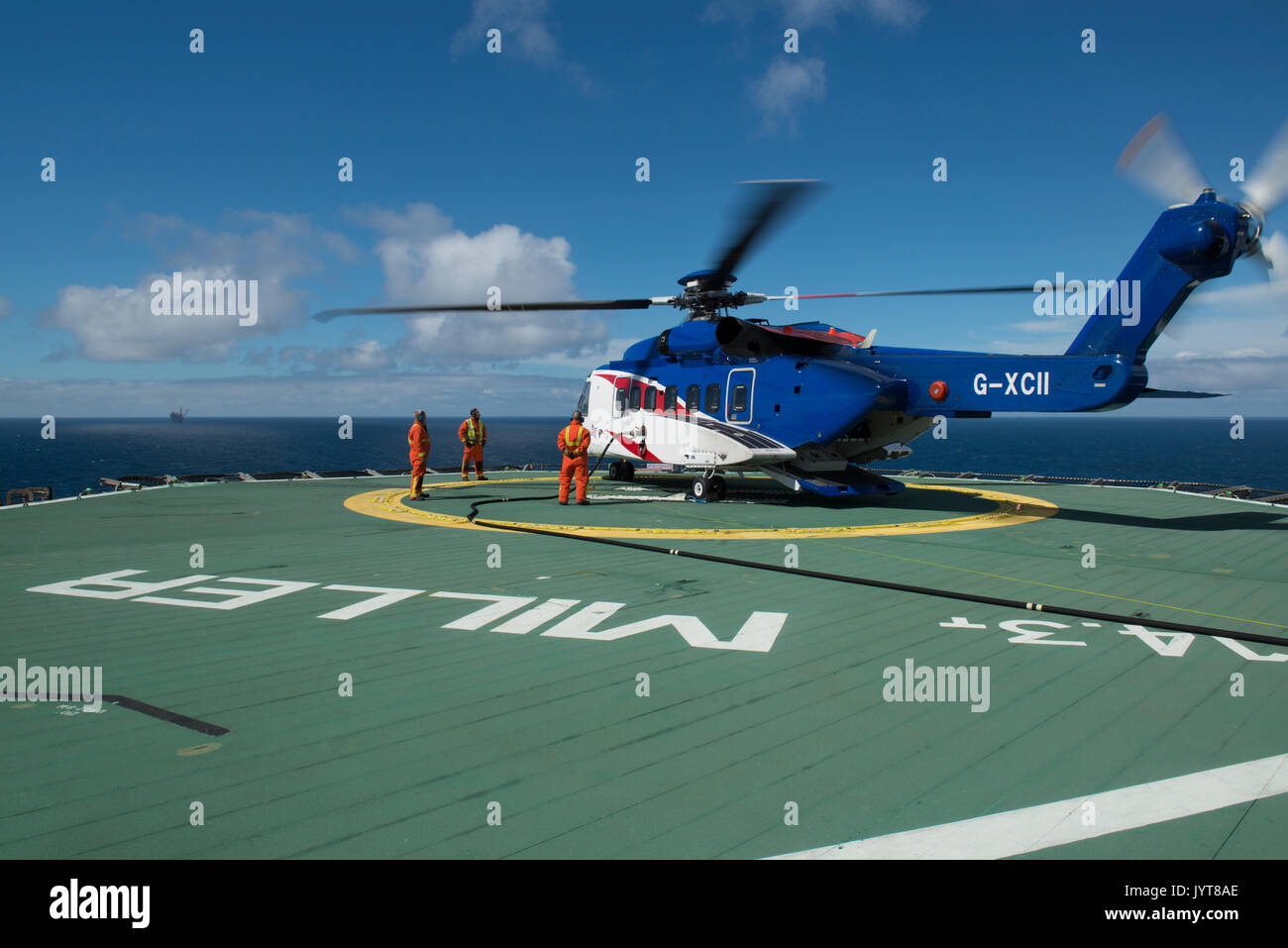 Bristow Helicopter, landing on a north sea oil and gas platform. Helideck team refuelling, credit: LEE RAMSDEN / Stock Photo