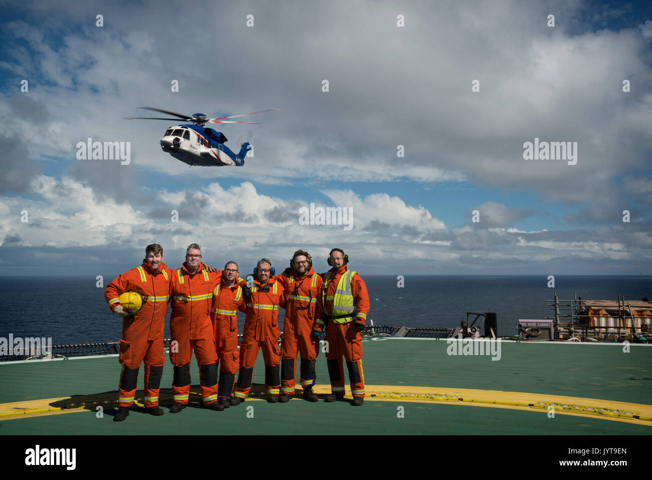 Bristow Helicopter flyby, north sea oil and gas platform. Helideck team, credit: LEE RAMSDEN / ALAMY - Stock Image