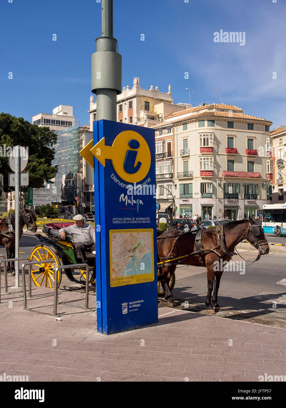 MALAGA, SPAIN:  Horse drawn carriages waiting tourists fares - Stock Image