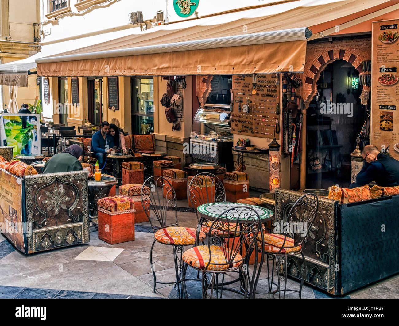 MALAGA,S PAIN:  Tourists at the pretty Pavement cafe Teteria Palacio Nazari Stock Photo