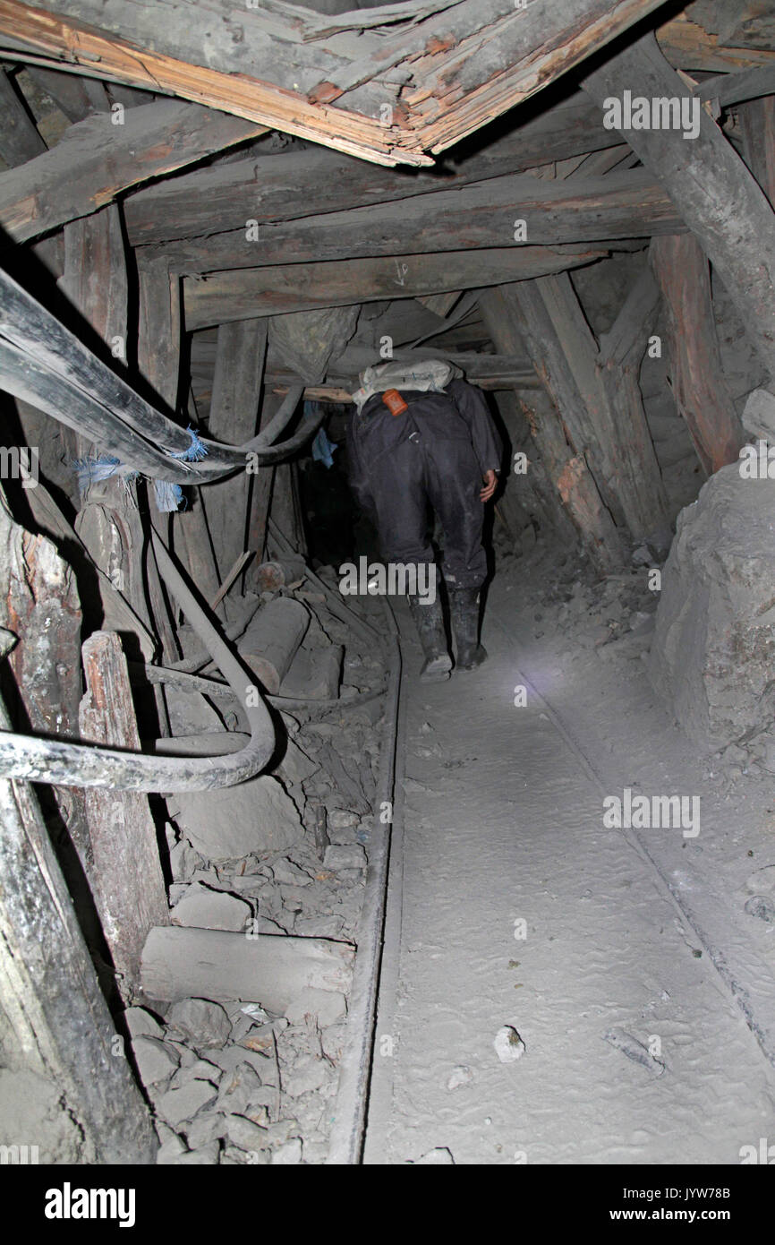 Following miners down the dark and dangerous shafts in one of the mines in Potosi, Bolivia - Stock Image