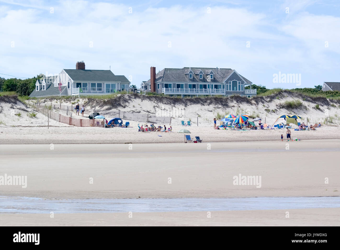 A day at the beach with upscale summer homes on Howes Beach - Dennis, MA - Cape Cod - Stock Image