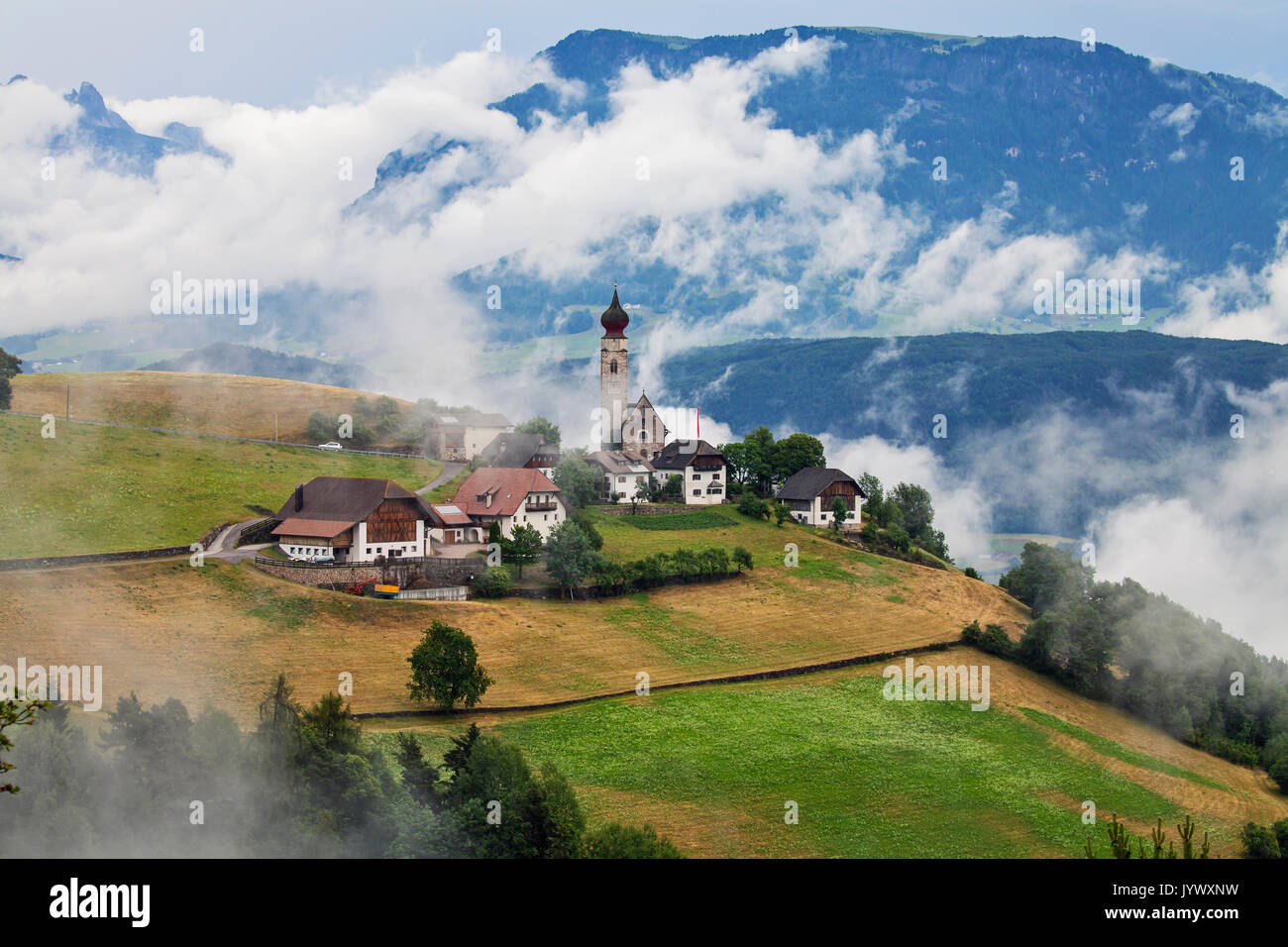 MONTE DI MEZZO, ITALY - JUNE 25, 2017: Village of Monte Di Mezzo with St Nikolaus Church;  situated in Dolomites, near  earth pyramids of Renon - Stock Image