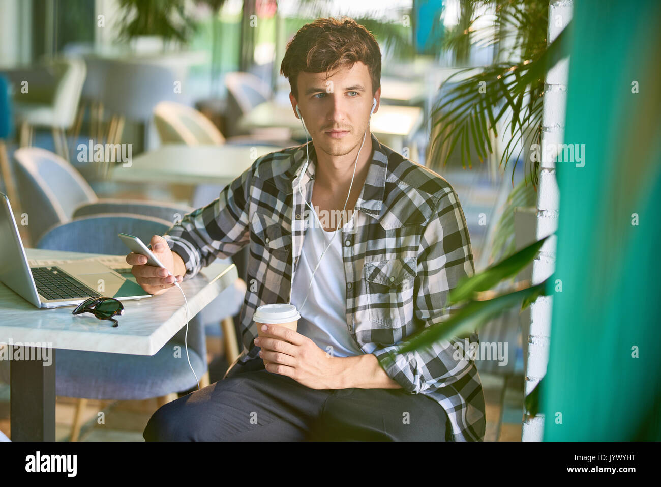 Handsome Young Man in Cafe - Stock Image