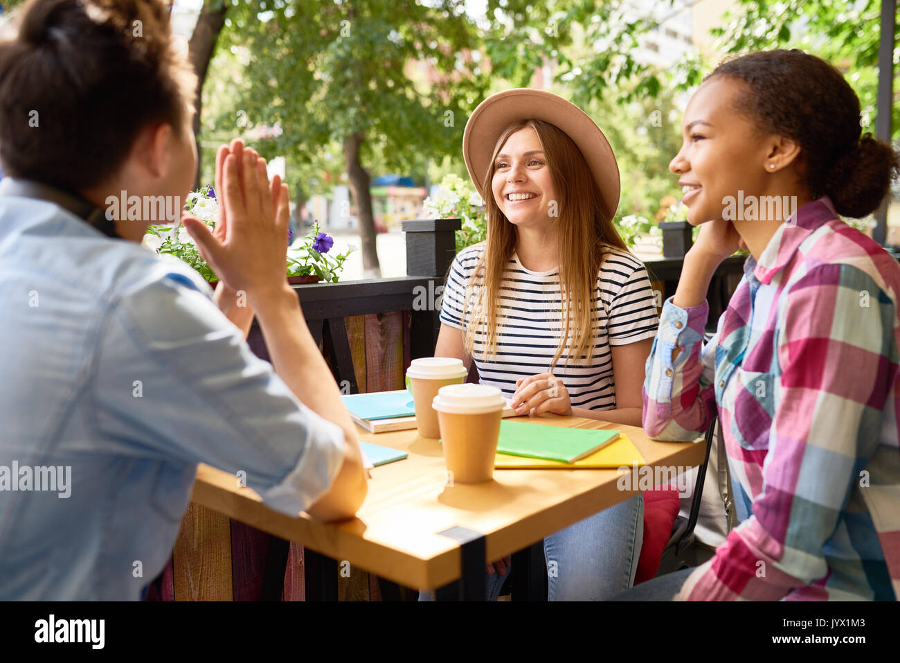 Group of Young People Studying in Cafe - Stock Image