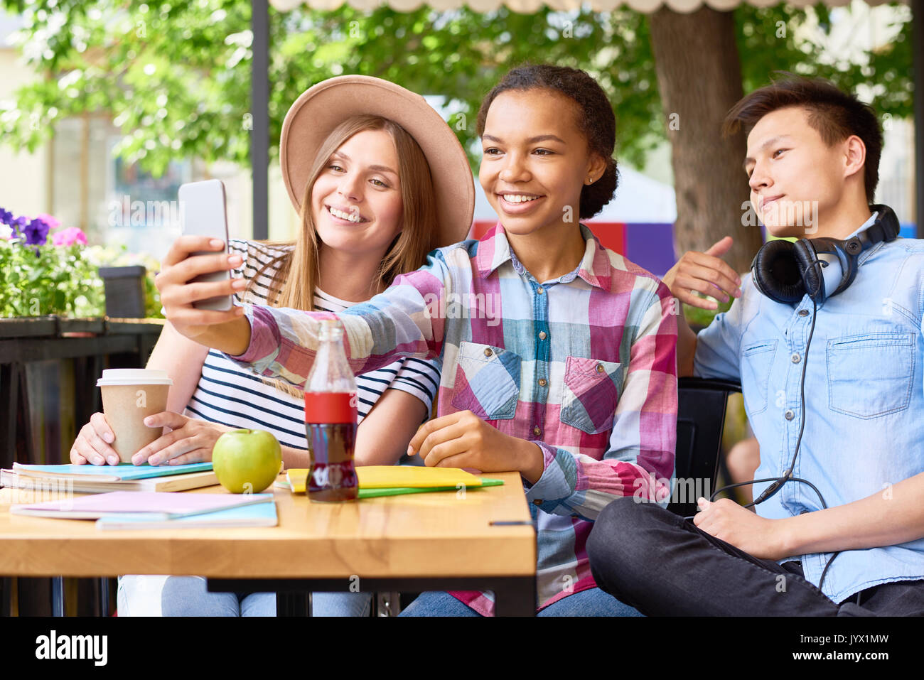 Young People Taking Selfie in Cafe - Stock Image