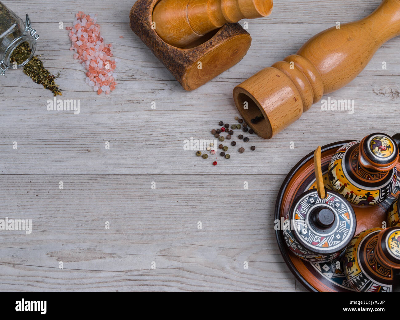 oils and spices top view with wooden background - Stock Image