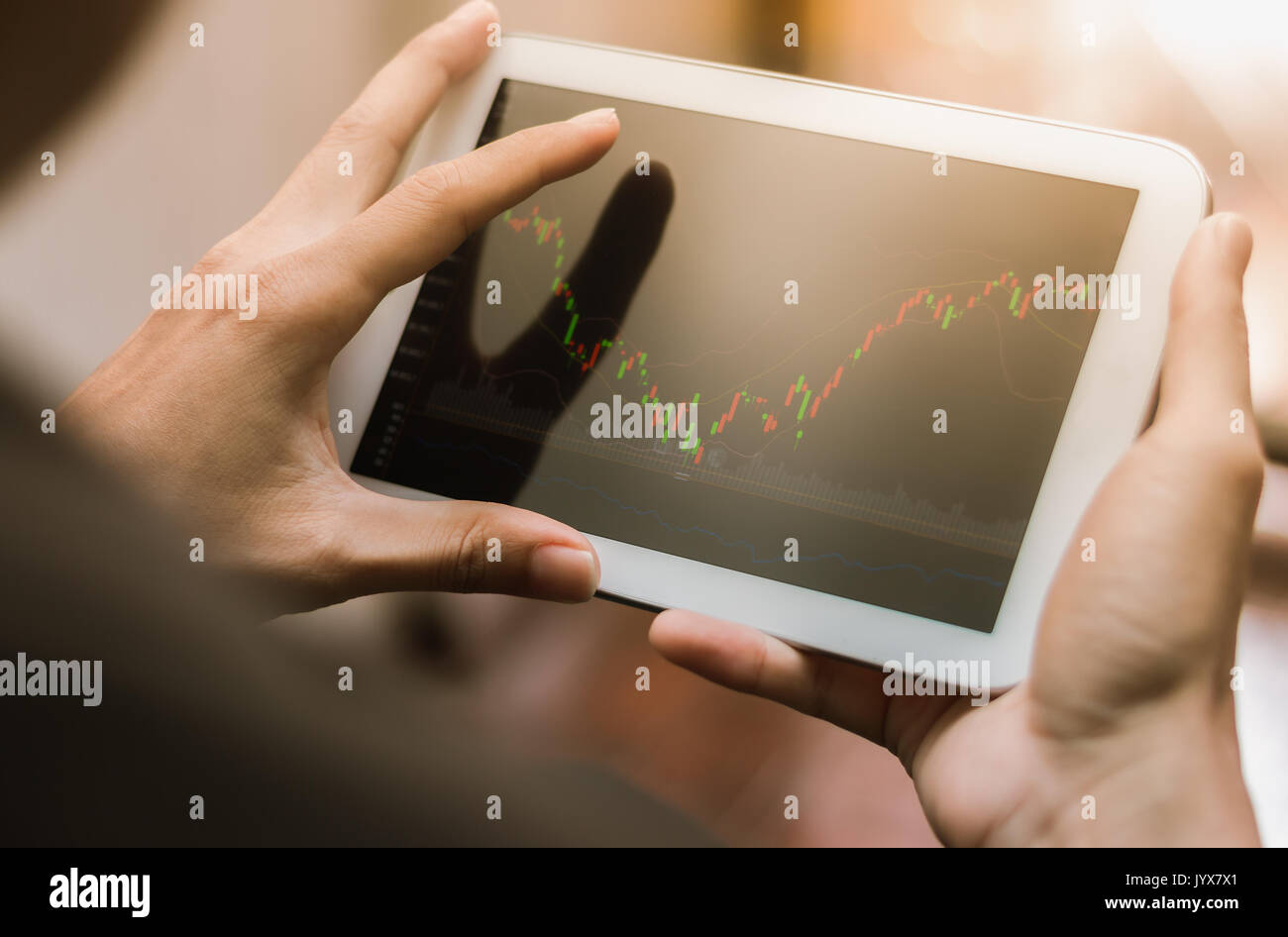 Business man checking stock market on tablet, smartphone - Stock Image