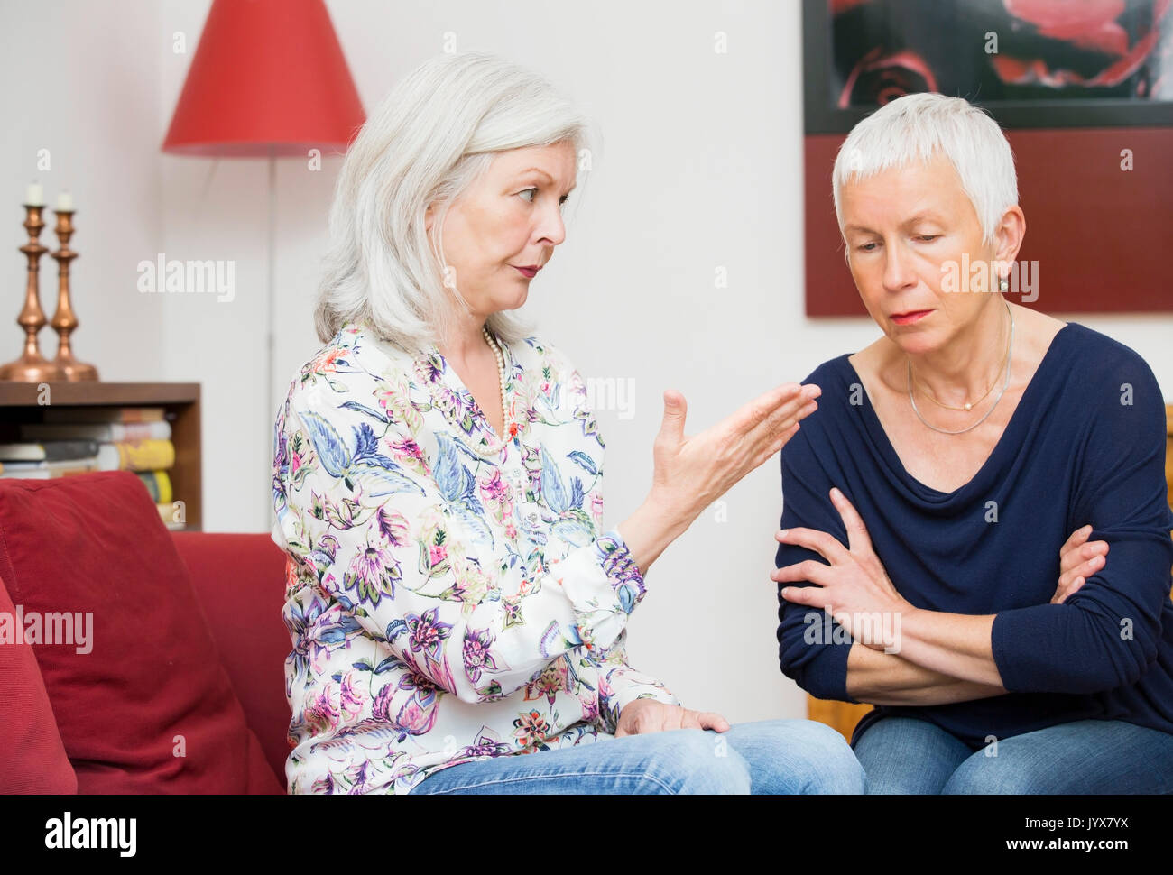 Two older woman in a disputation - Stock Image
