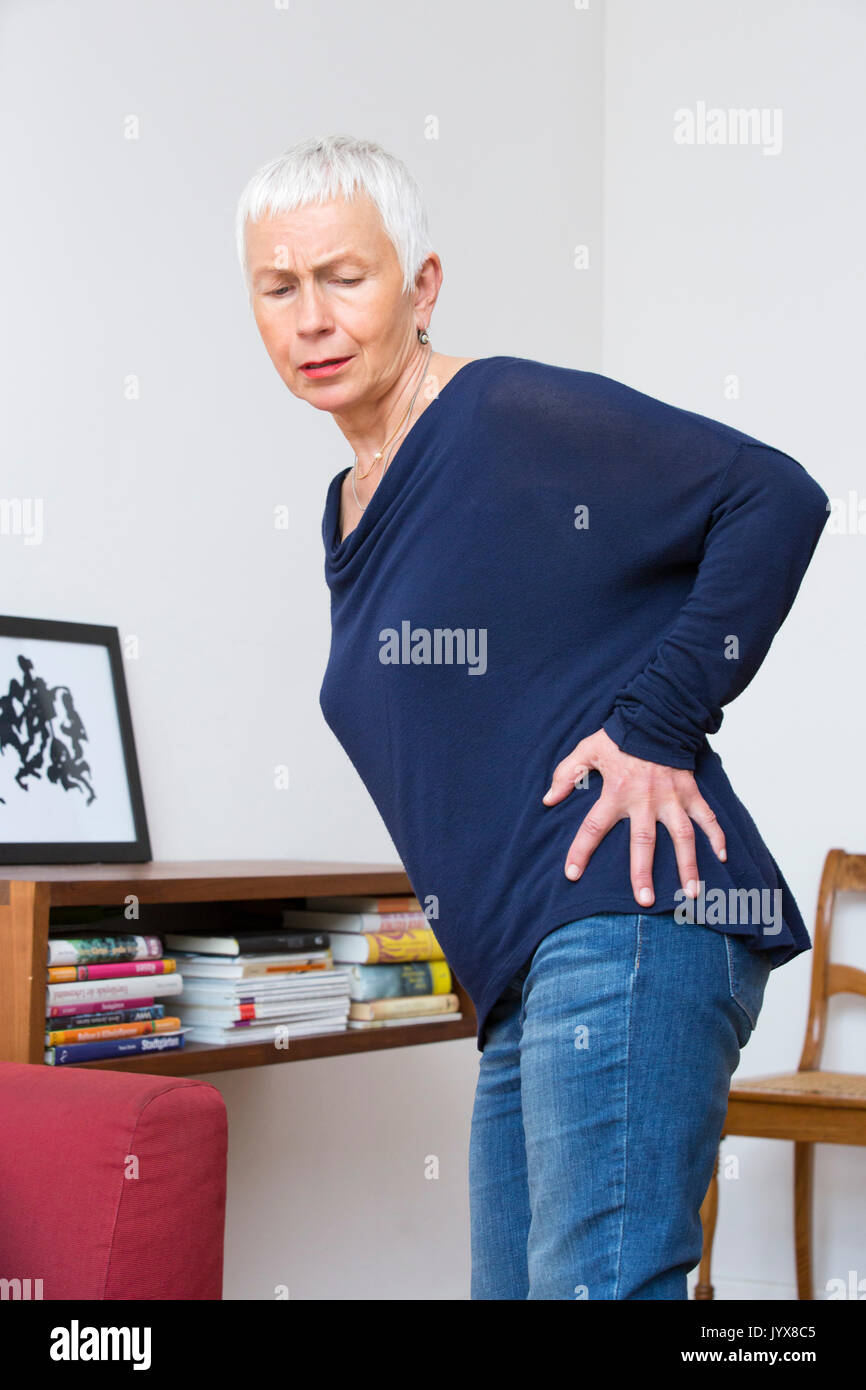 Woman with hip troubles - Stock Image