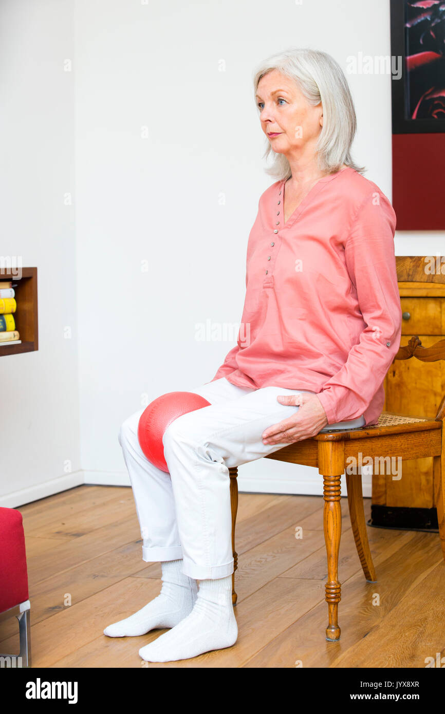 Older woman does pelvic floor exercises - Stock Image