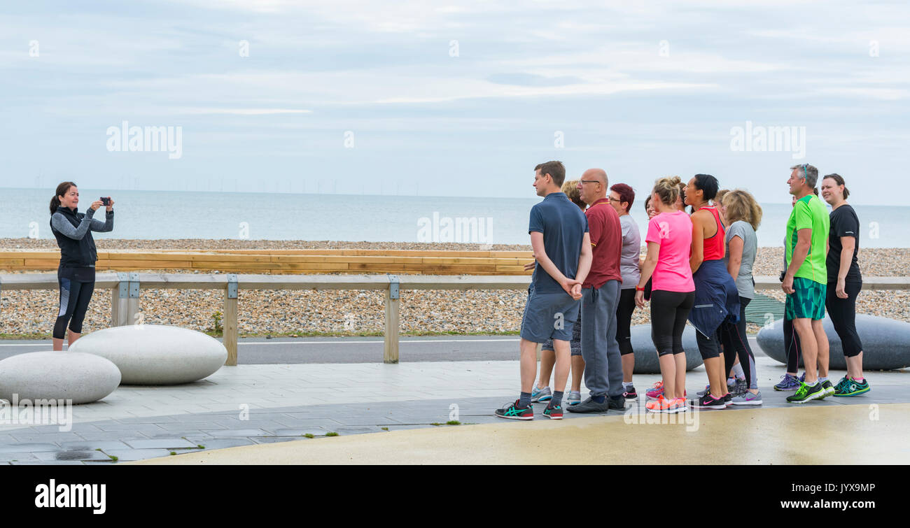 Taking photos of a group of people. - Stock Image