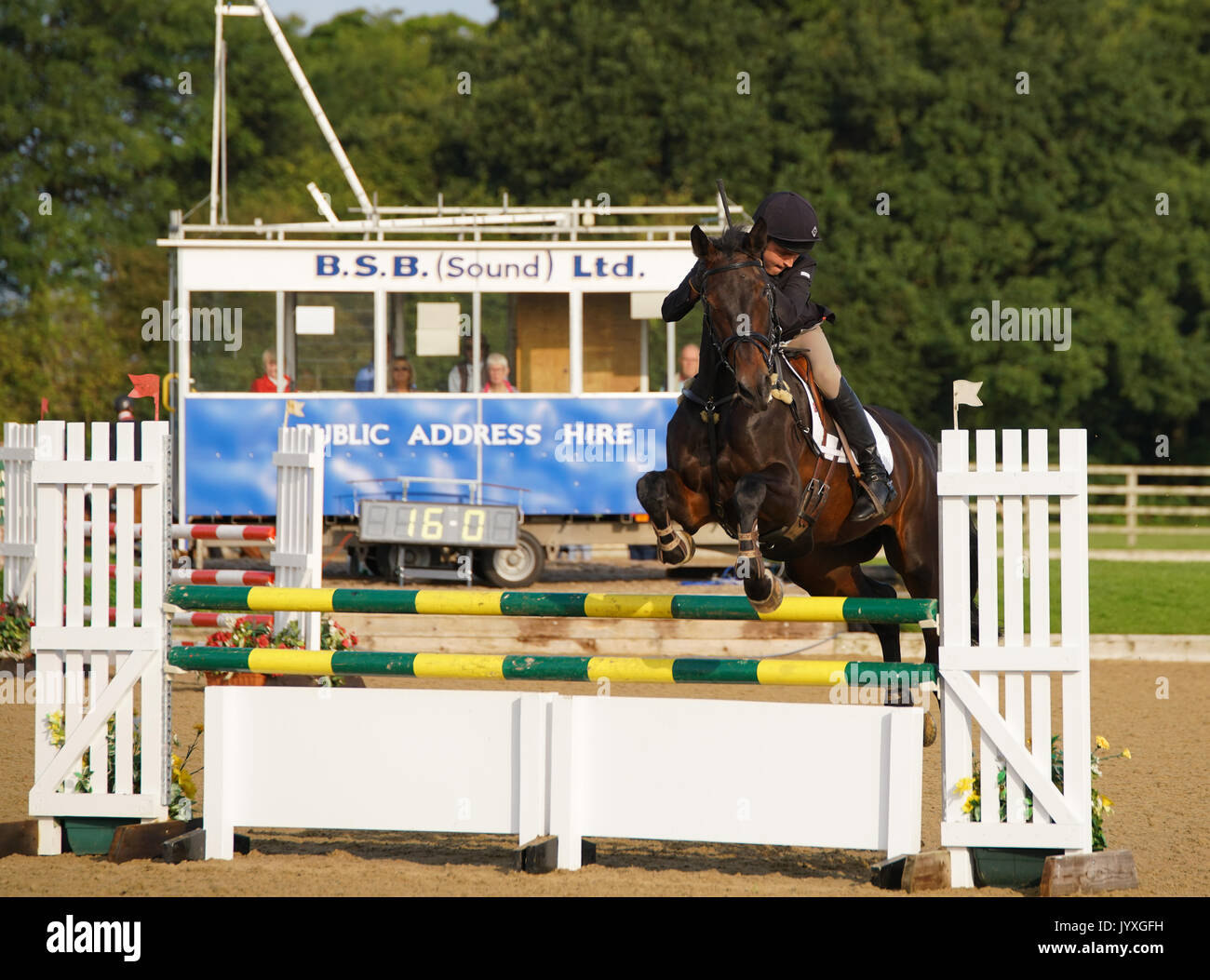 Congleton, UK. 20th Aug, 2017. Somerford Park International horse trials, Sunday, day 3, riders compete in the British eventing CIC* and CIC** Show jumping and cross country. Credit: Scott Carruthers/Alamy Live News - Stock Image