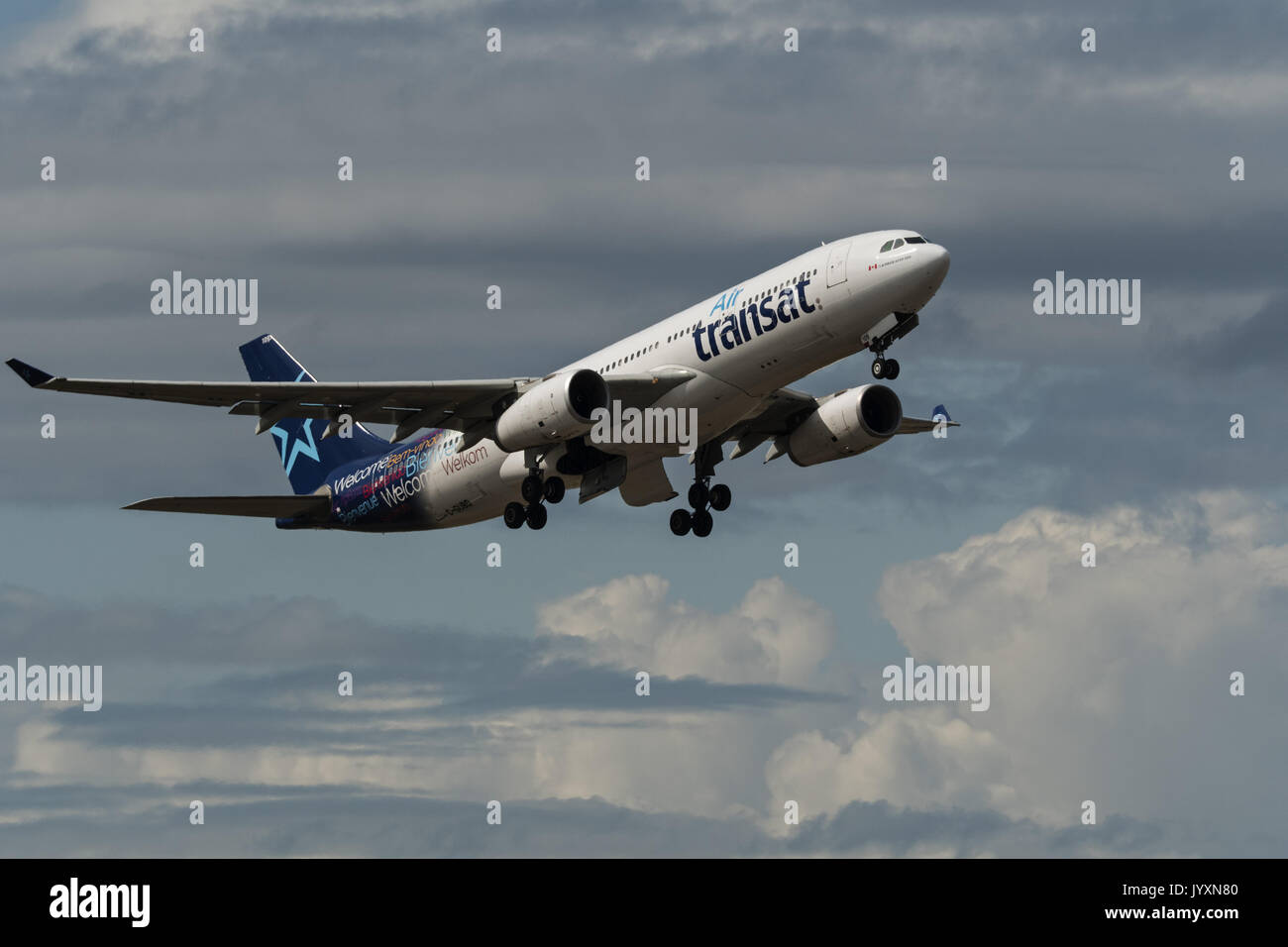 Richmond, British Columbia, Canada. 18th Aug, 2017. An Air Transat Airbus A330 (C-GUBD) wide-body jet airliner takes Stock Photo