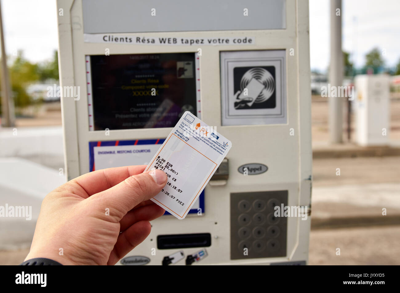 PARIS, FRANCE - MAY 14, 2017 : Man holding a parking ticket