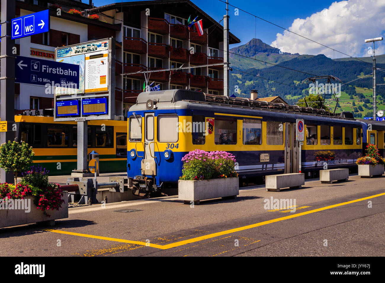 Grindelwald, Bernese Oberland, Switzerland - AUGUST 1, 2017 : Yellow - Blue train from the Berner Oberland-Bahn to Interlaken in the Grindelwald railw - Stock Image