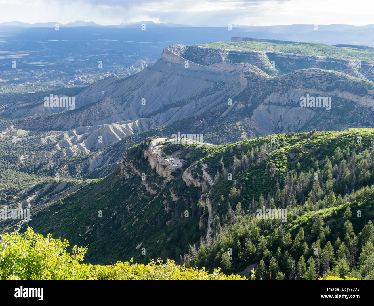 Scenic view from the Mesa Verde elevated plateau across the Mesa Verde tableland and the underlying plains. - Stock Image