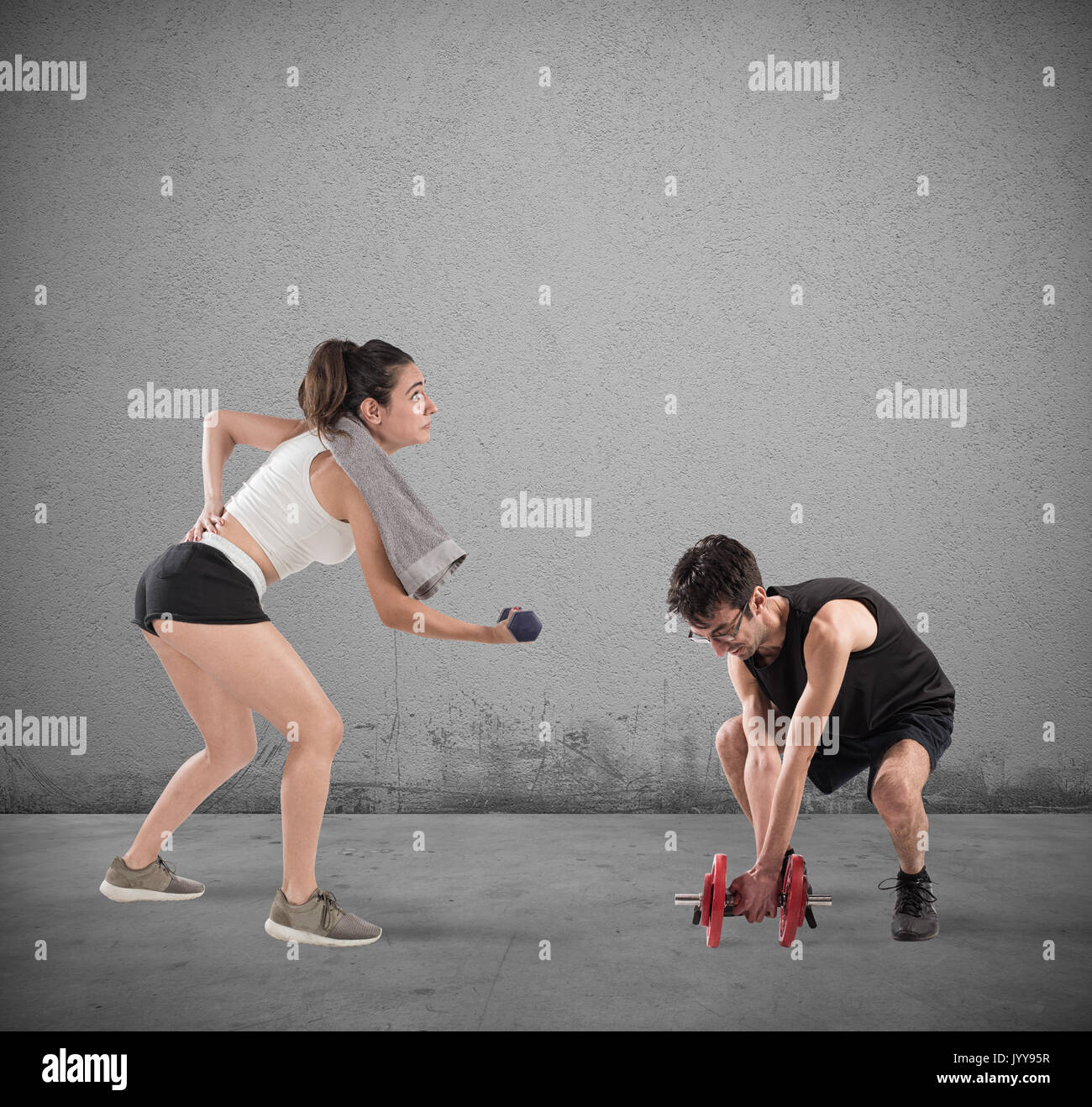 Boy and girl having difficulty at the gym - Stock Image