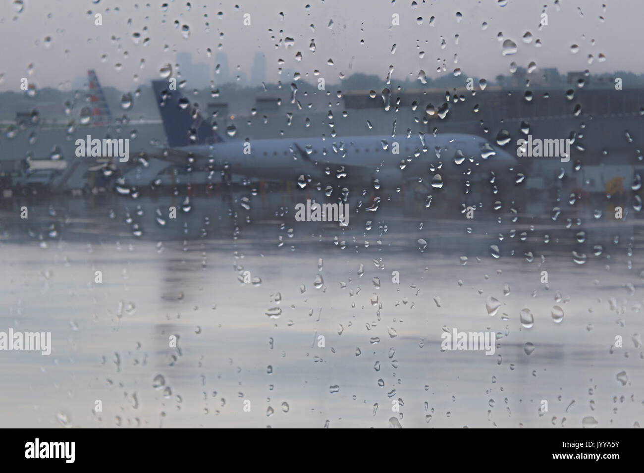 Airplane At Airport Delayed Due To Rain Storm - Stock Image