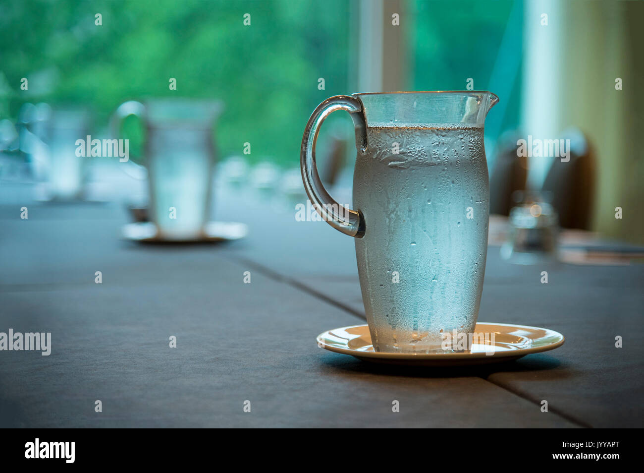 Water Pitcher On Conference Room Table Prior To Meeting - Stock Image