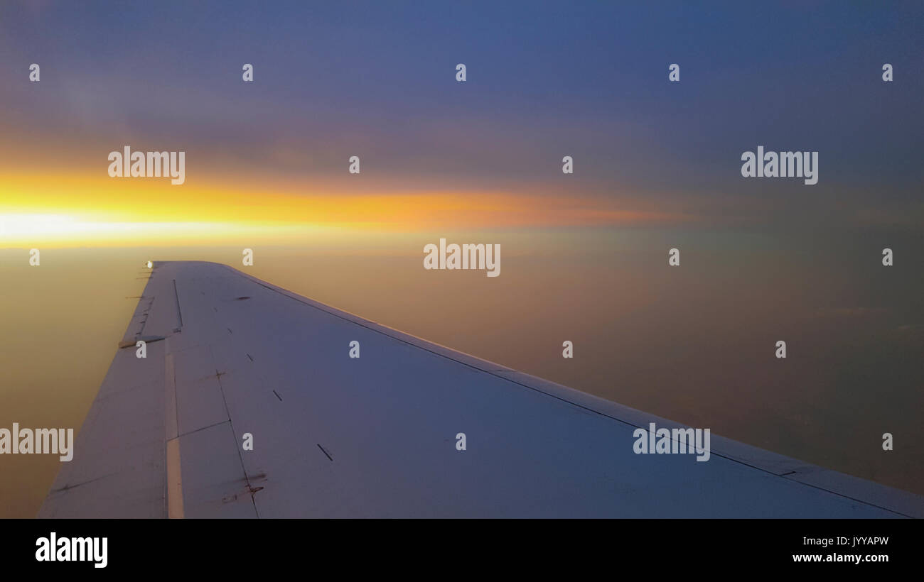 Airplane Wing At Sunset - Stock Image