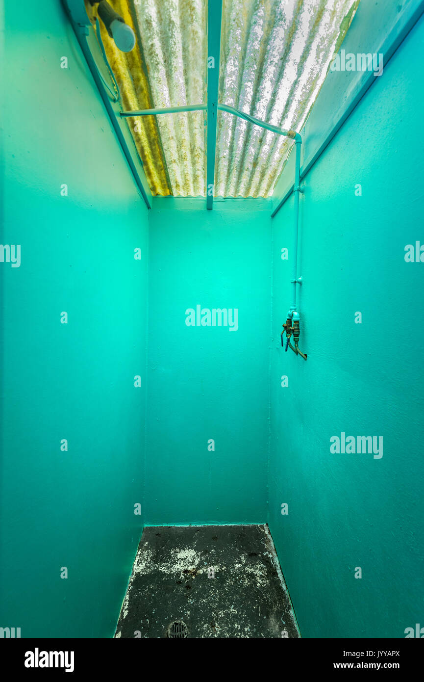 Small Colorful Industrial Empty Closet Room - Stock Image