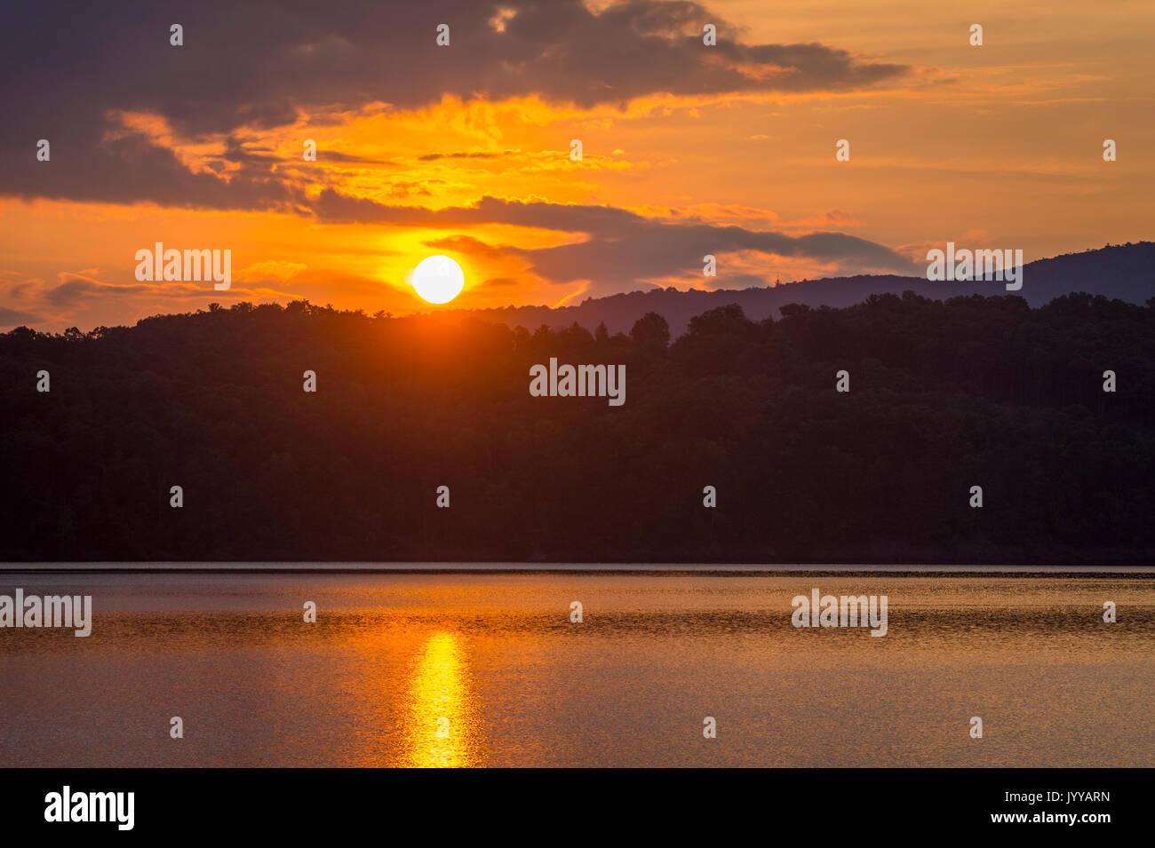 Sunrise On Beautiful Calm Mountain Lake - Stock Image