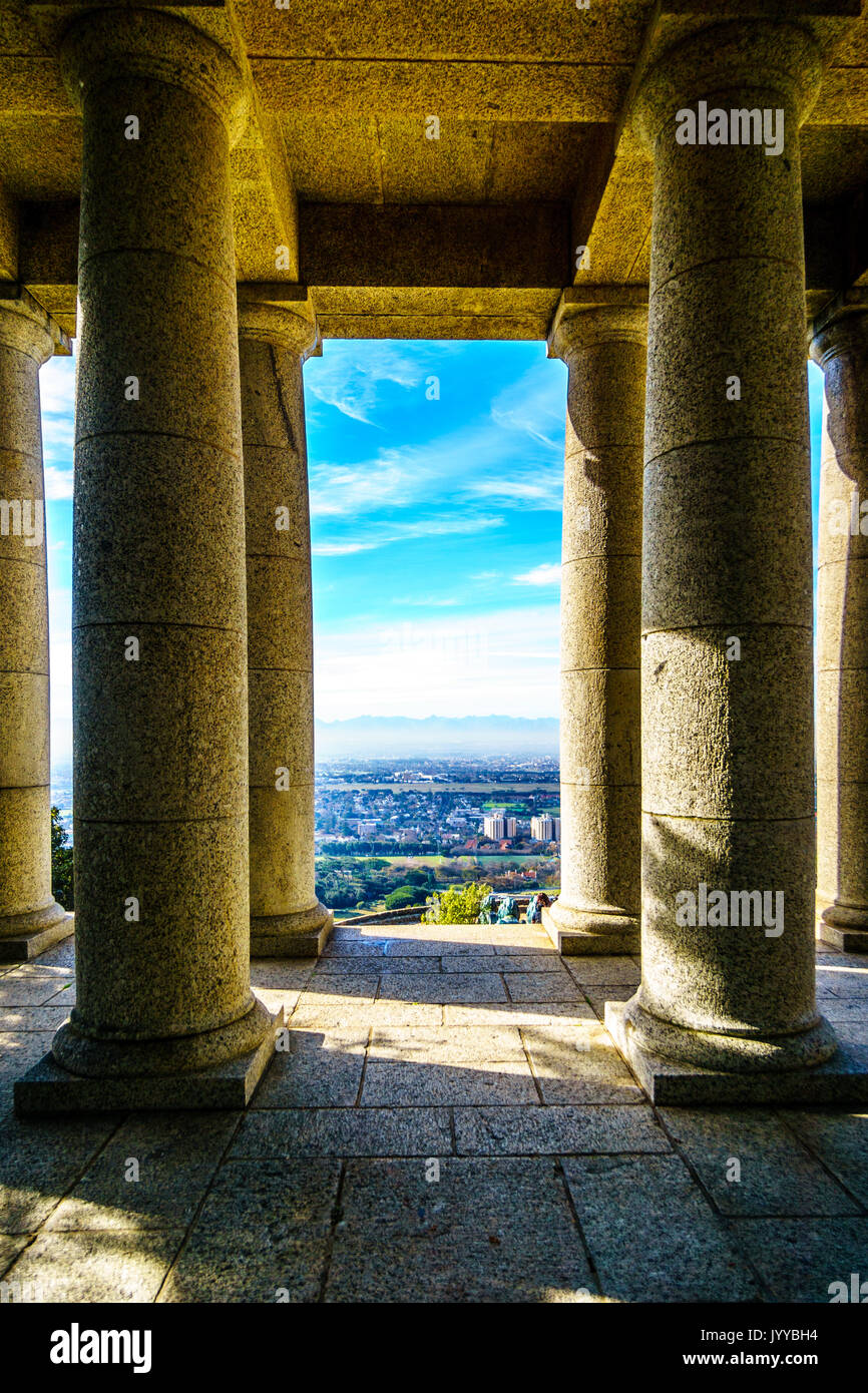 The Cape Peninsula seen from between the colonnades of Cecil Rhodes monument on the slopes of Table Mountain at Cape Town South Africa - Stock Image