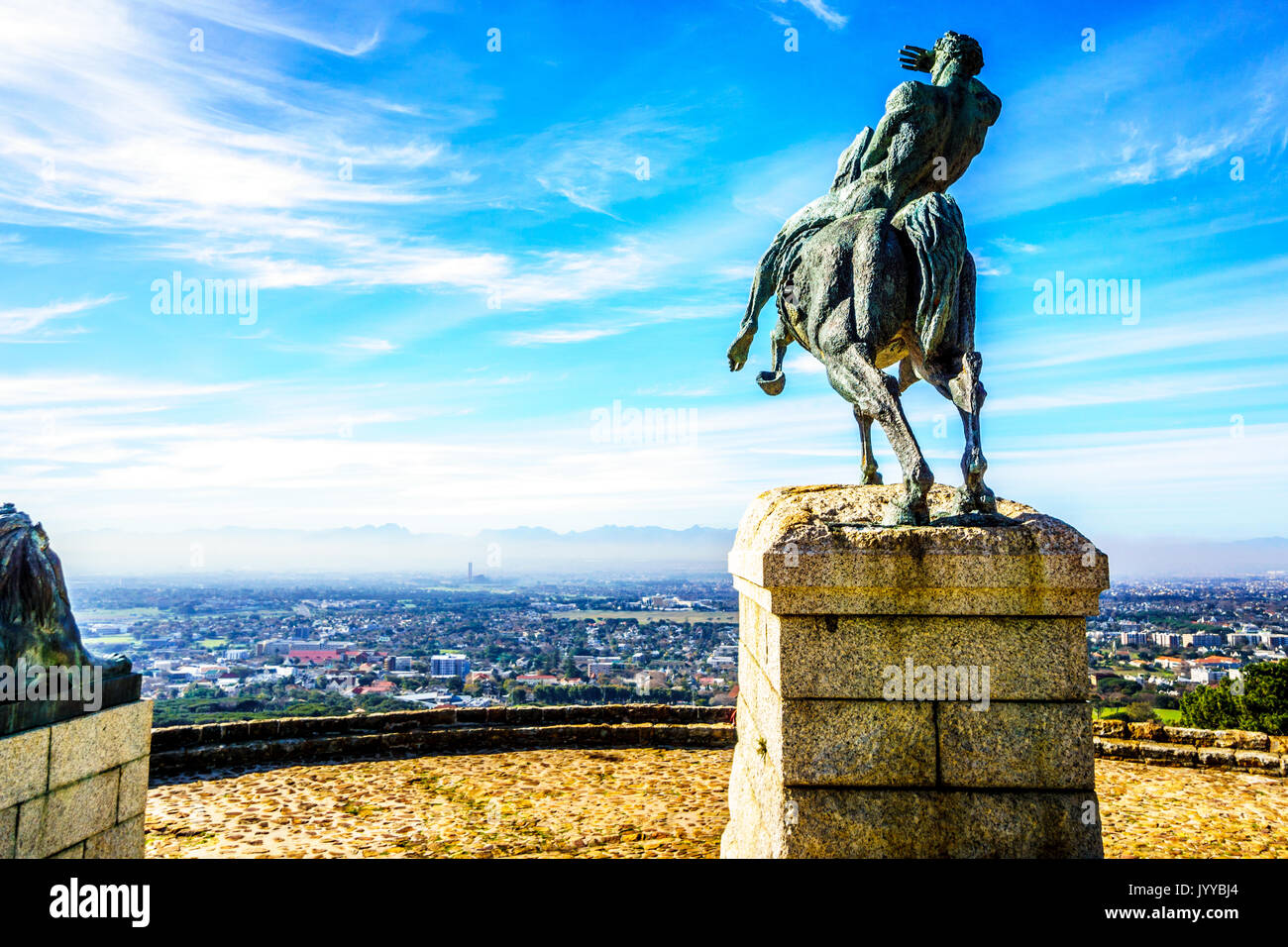 Bronze statue of Cecil Rhodes overlooking Cape Peninsula from the slopes of Table Mountain at Cape Town South Africa Stock Photo