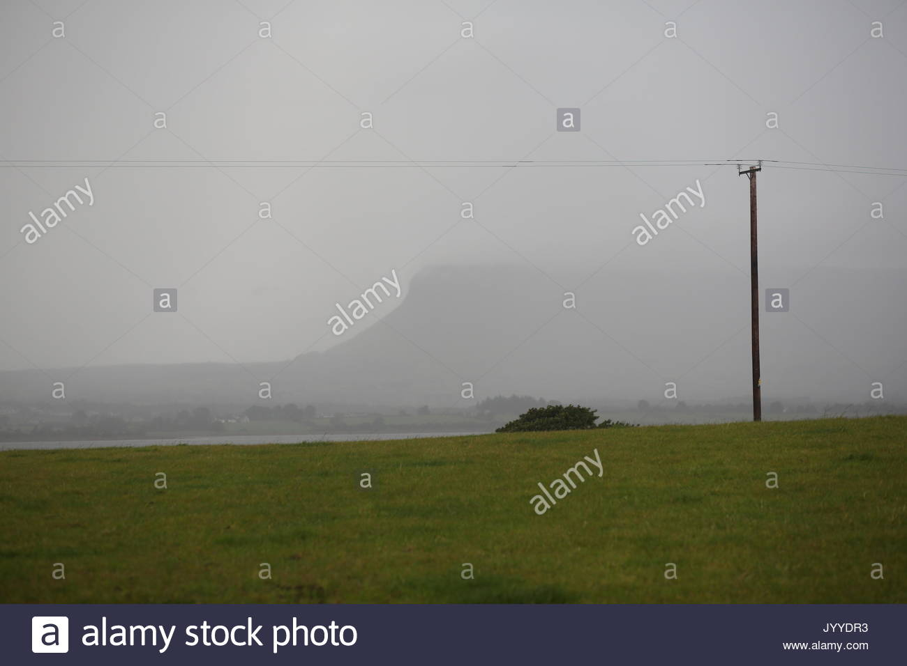 Mist falls across Ben Bulben as rain approaches in County Sligo, Ireland , along the wild Atlantic way. - Stock Image