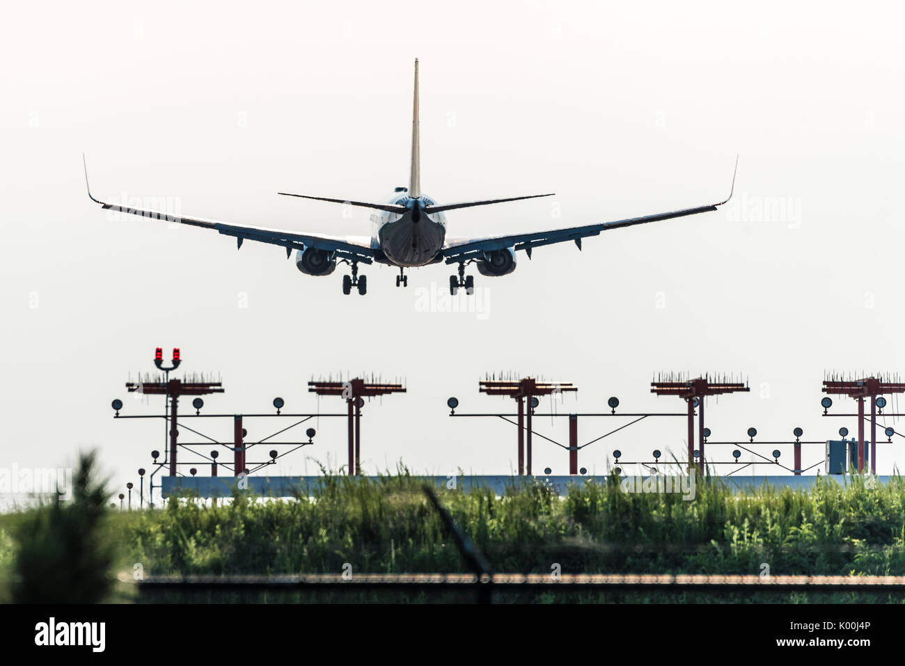 Delta Air Lines jet in descent for landing over the runway approach lights at Hartsfield-Jackson Atlanta International Airport in Atlanta, Georgia. - Stock Image
