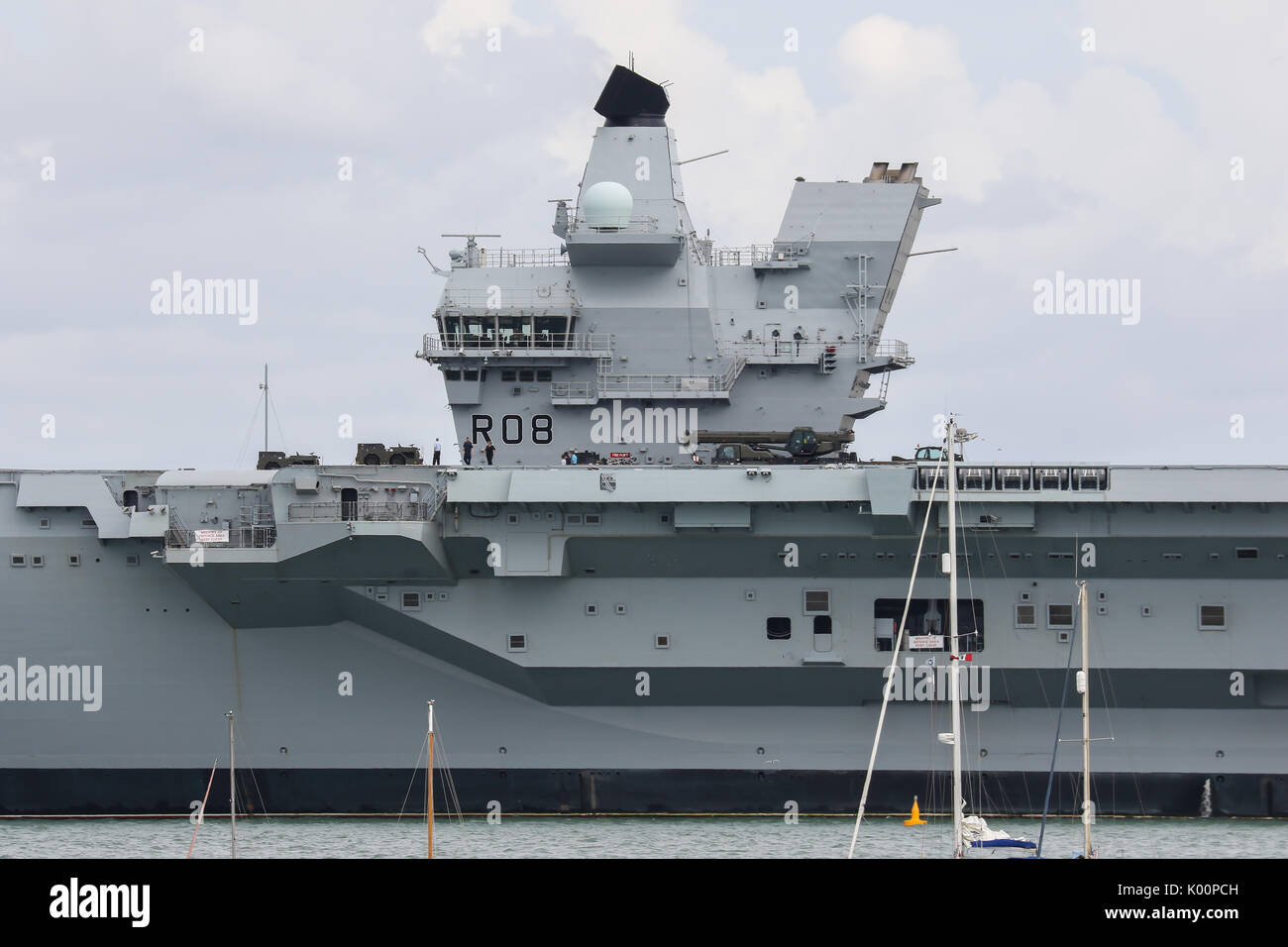 HMS Queen Elizabeth (R08) sits in HM Naval Base Portsmouth following arriving to her home-port for the first time - Stock Image