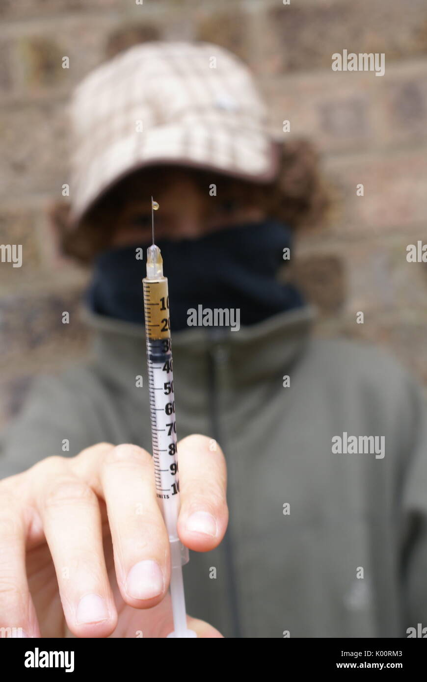 drug dependency, injecting heroin - Stock Image