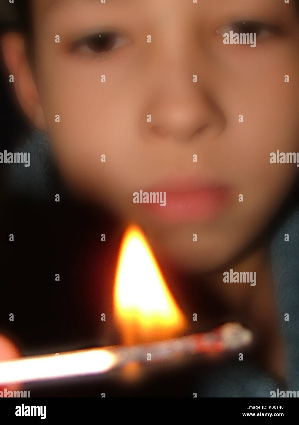 ARSON, child playing with fire - Stock Image