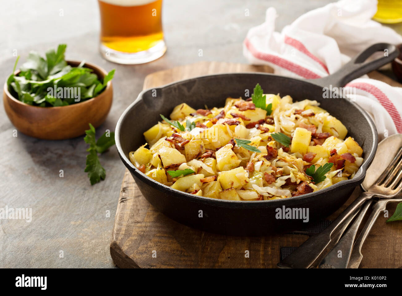 Fall side dish with fried cabbage, potatoes and bacon - Stock Image