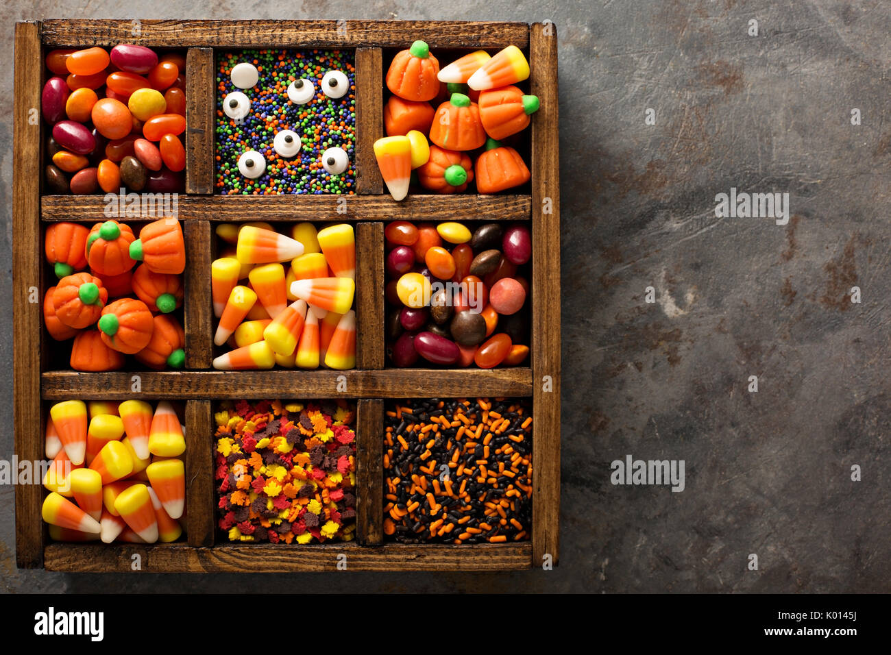 Halloween candy and sprinkles in wooden box - Stock Image