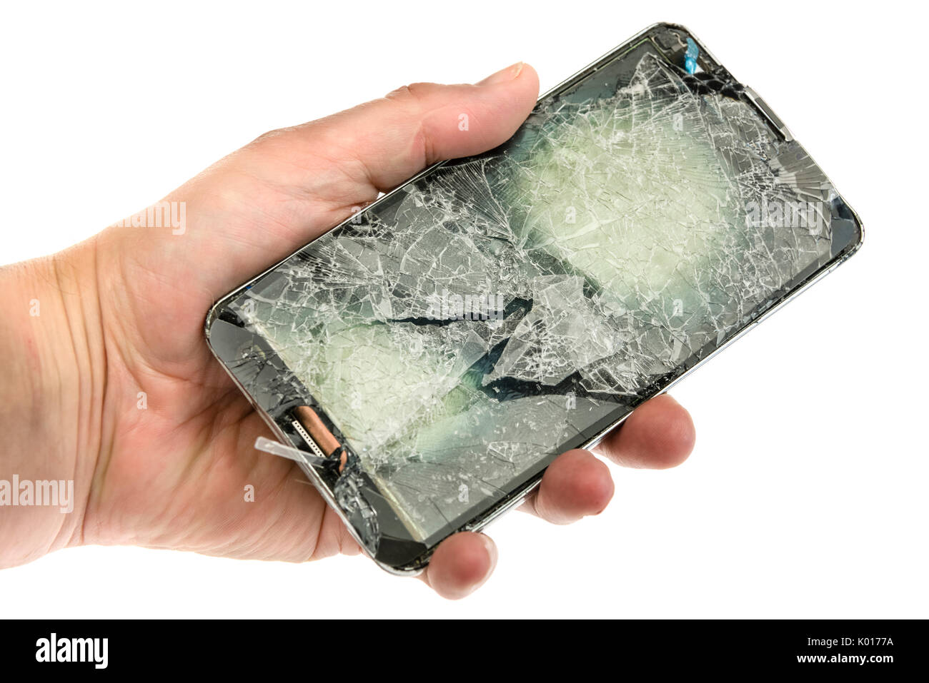 Mobile phone with a badly shattered screen after a serious fall. Stock Photo