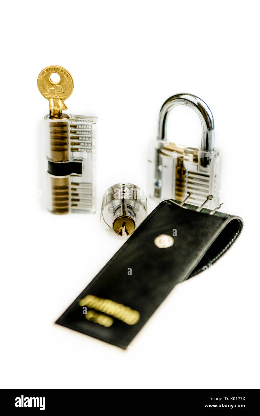 Selection of transparent locks including a padlock, Yale cylinder and a Euro profile cylinder, with a lock-pick set, for learning principles of lock p - Stock Image