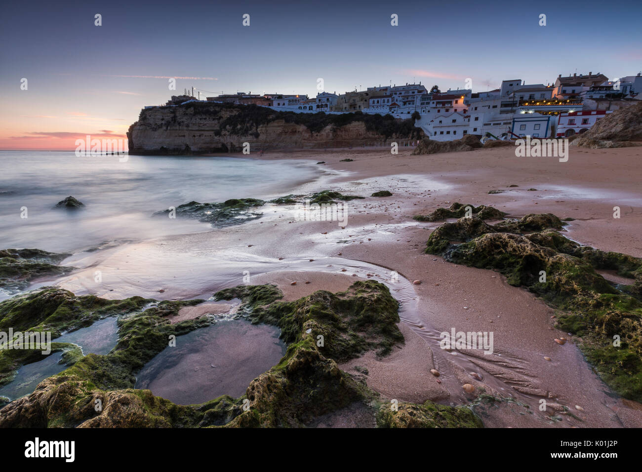 Sunset on the village perched on the promontory overlooking the beach of Carvoeiro Algarve Lagoa Faro District Portugal Stock Photo