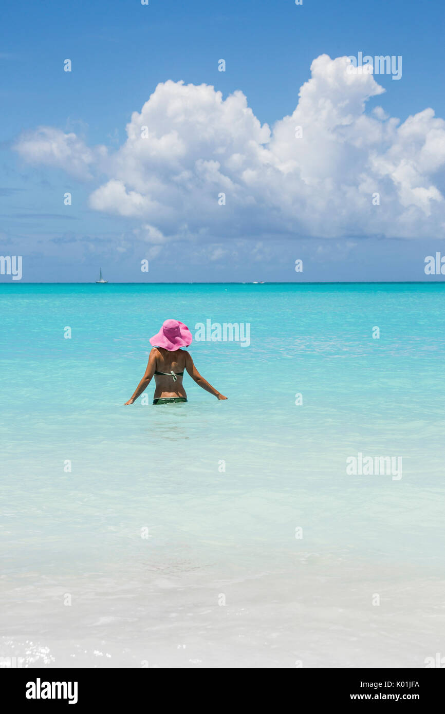 Bather in the turquoise waters of the Caribbean Sea Jolly Beach Antigua and Barbuda Leeward Island West Indies - Stock Image