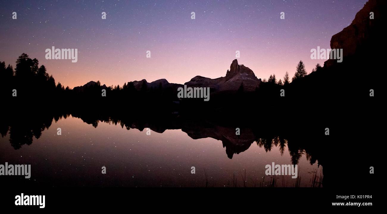 Becco di Mezzodi reflecting in the tranquil water of Lake Federa by Palmieri Hut at night Dolomites of Belluno Trentino Alto Adige Italy Europe - Stock Image