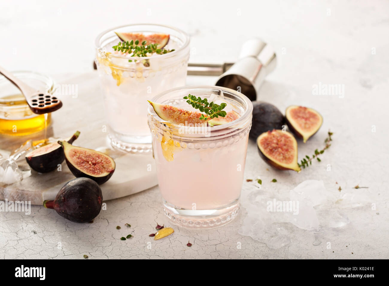Pink fig cocktail with honey and thyme - Stock Image