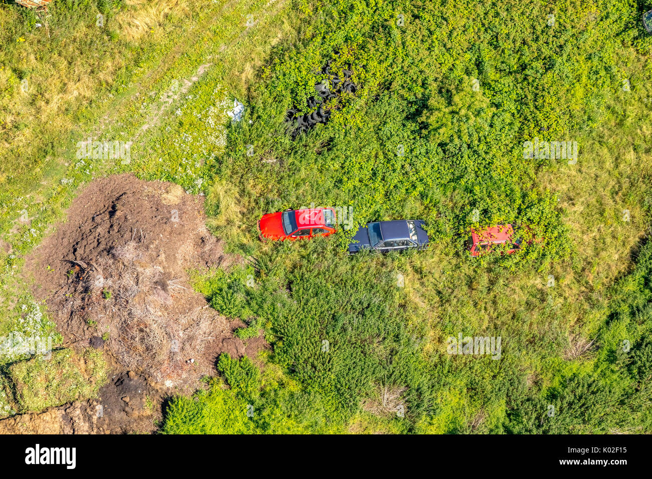 wild Old car pile in Esborn, overgrown junk cars are in nature, Wetter (Ruhr), Ruhr area, North Rhine-Westphalia, Germany, Europe, Aerial View, Aerial - Stock Image