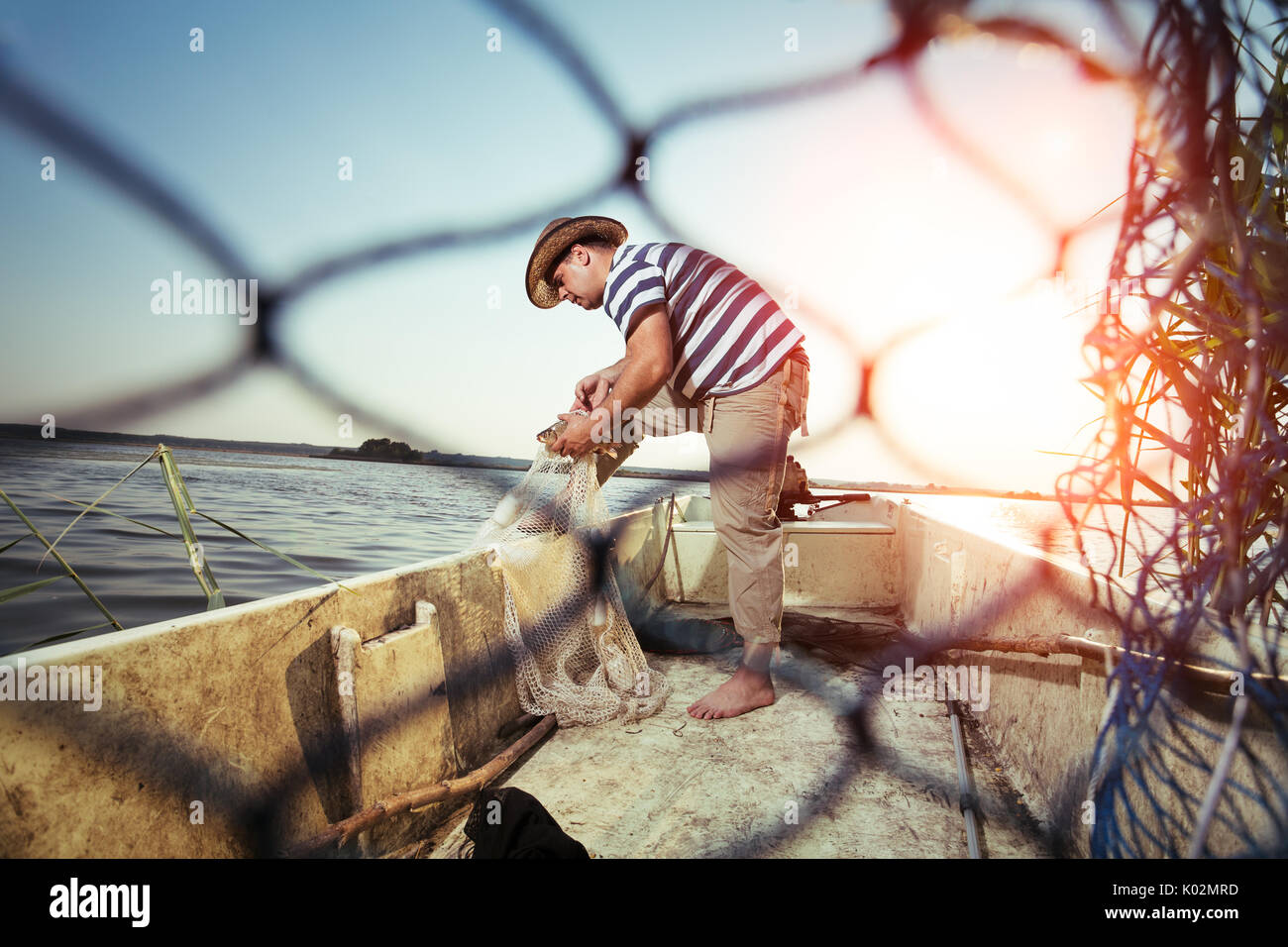 Fisherman fishing in the boat Stock Photo
